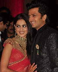 Genelia has worn a Red Sari & Riteish a Sherwani for their Wedding reception