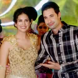 Picture of Sunny Leone and her husband, Daniel Weber at an event.