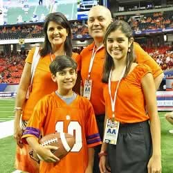 South Carolina Governor and Clemson Alumini, Nikki Haley, with husband, Michael, and kids Nalin and Rena.