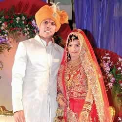 Cricketer Umesh Yadav and wife, Tania Wadhwa, receiving guests at their wedding.