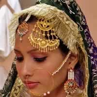 Jhoomar is a big wedding jewellery that is worn on the hair.